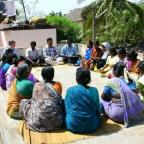 Weekly meeting of borrowers for a microfinance institution in South India
