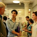Prof. Dennis Smith (left) greets first-year Wagner students.