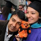 Loved ones and friends rejoin the graduates outside BAM, with tokens of their pride and esteem at th