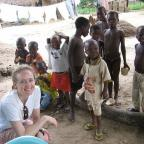 Accra, Ghana: Leanne Webster meets with children while visiting a microfinance farming community as