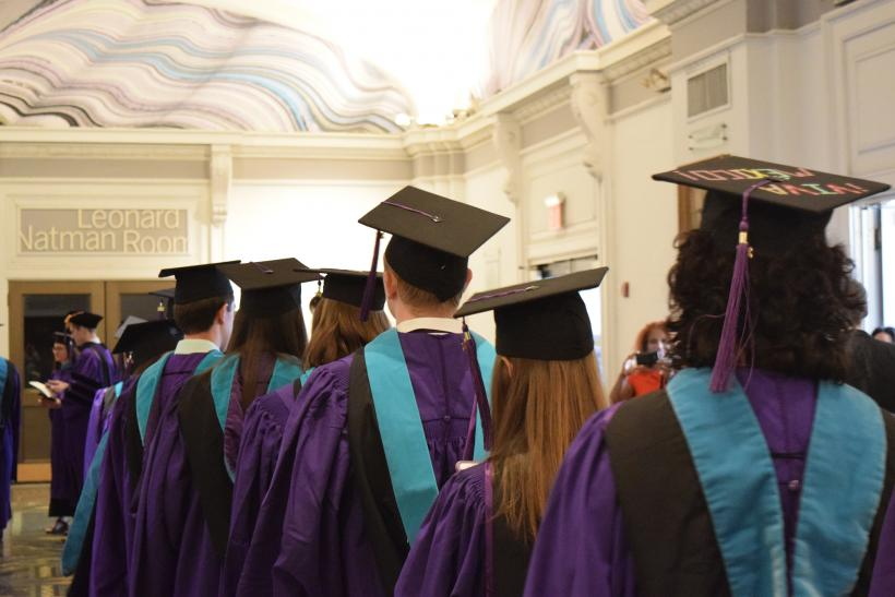 Students lining up in graduation gowns