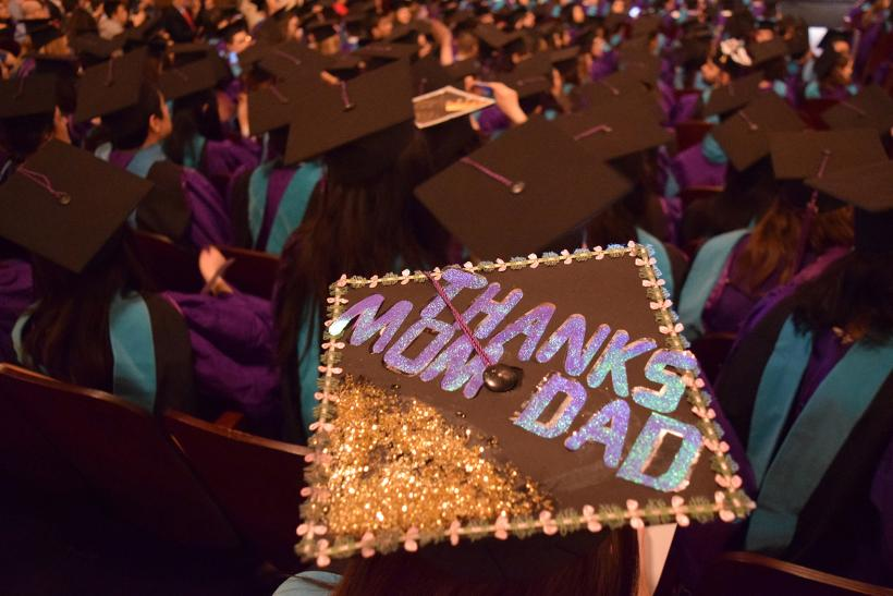 "Decorated student graduation cap which reads ""Thanks Mom & Dad"""