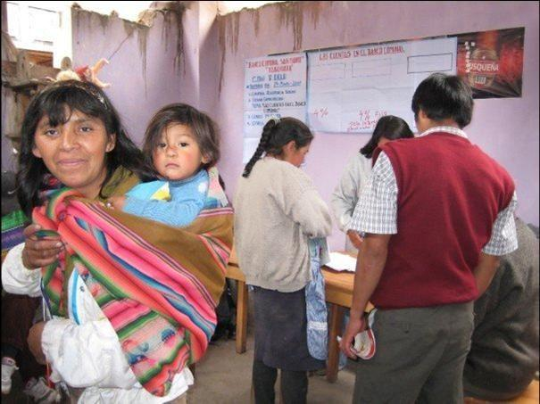 Village bank meeting and clients of microfinance provider ARARIWA in rural Cusco, Peru