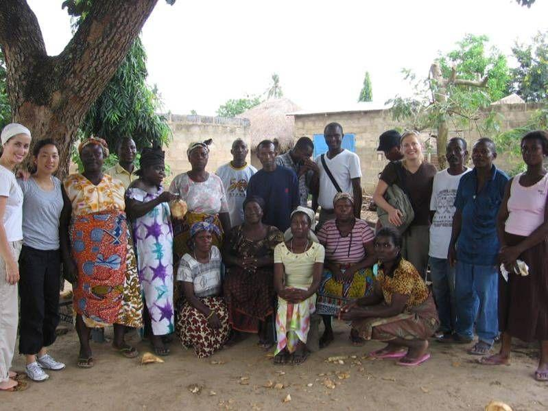Wagner student group visits a farming community as part of the Ghana course practicum with a microfi