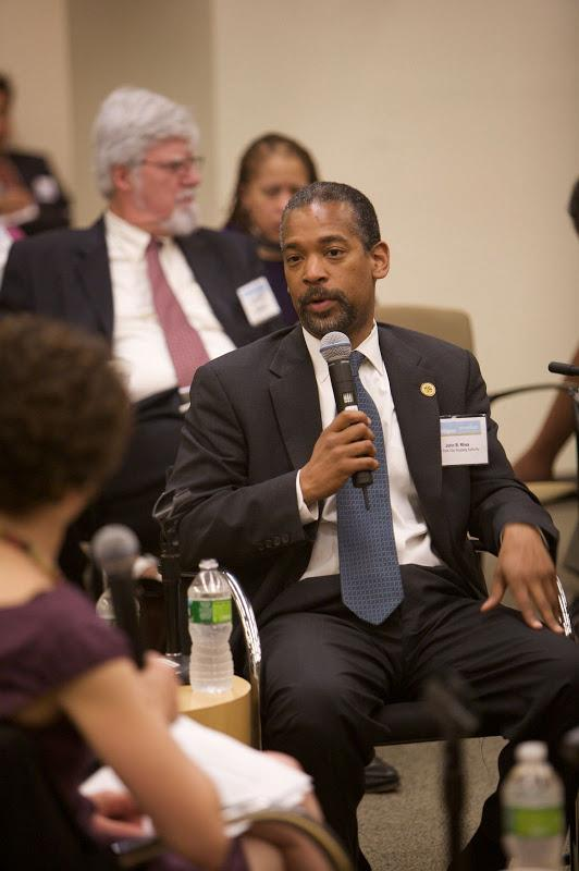 John B. Rhea, Chairman of the NYC Housing Authority, talks during an executive briefing for governme