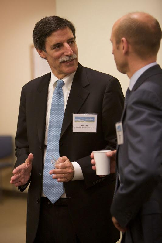 Marc Jahr, President of the NYC Housing Development Corporation, talks with Steve Hurst, co-chair of