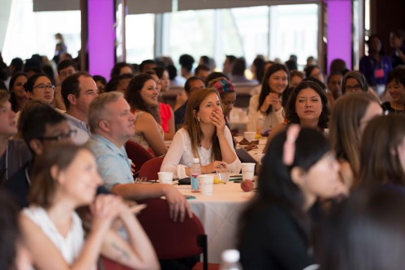 Audience sitting at tables