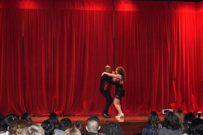 Two people dancing with each other on stage