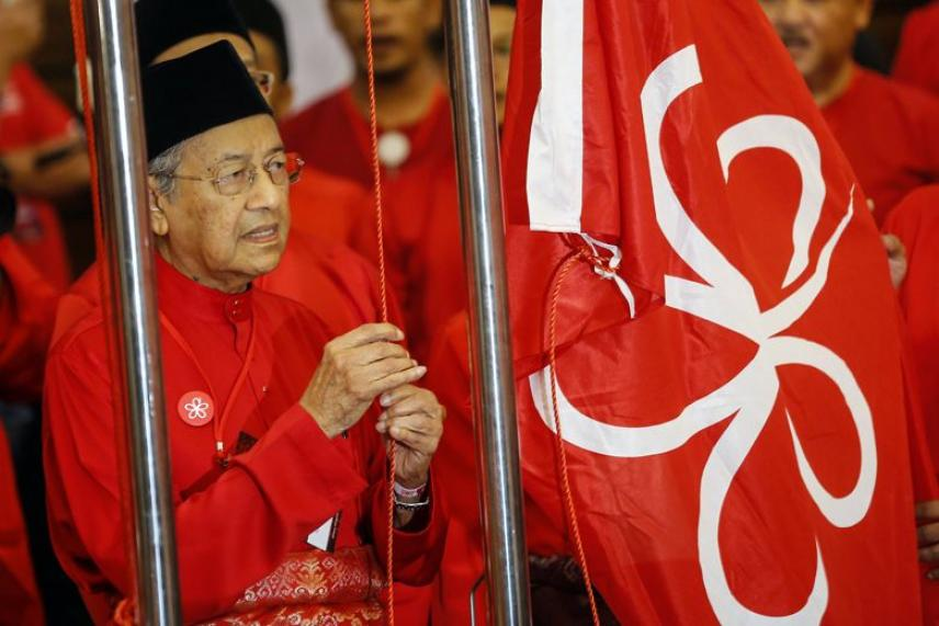 Malaysia's former premier Mahathir Mohamad is the opposition coalition's choice for Prime Minister if it wins in the country's next general election. He must give up the prime minister's position - should the opposition coalition win in the next general election - to jailed opposition leader Anwar Ibrahim, once Anwar is released from prison and given a royal pardon.