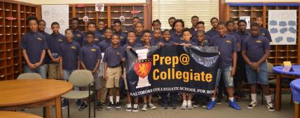Prep@Collegiate students photographed with the school's banner.