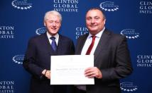 President Clinton and UCL Prof. David Coen