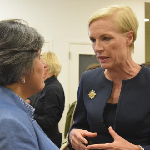 Cecile Richards speaking with guests at the networking reception