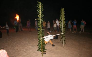A bonfire and limbo contest at Coconut Beach in Elmina Photo by Sandra Vu