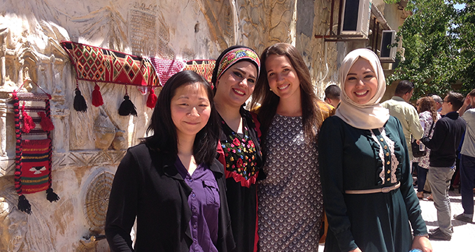 Justine Jacob with her Jordanian dialect teachers during an end of year celebration at her language center in Amman (2017).